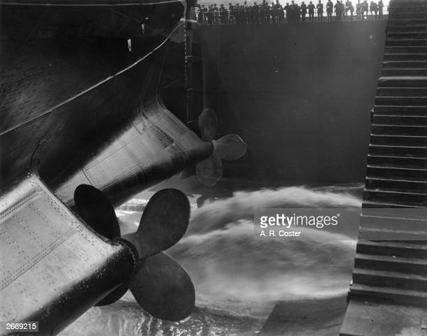 Water pours into the dry dock at Southampton prior to the relaunch of Cunard's Berengaria formerly the Hamburg America liner Imperator