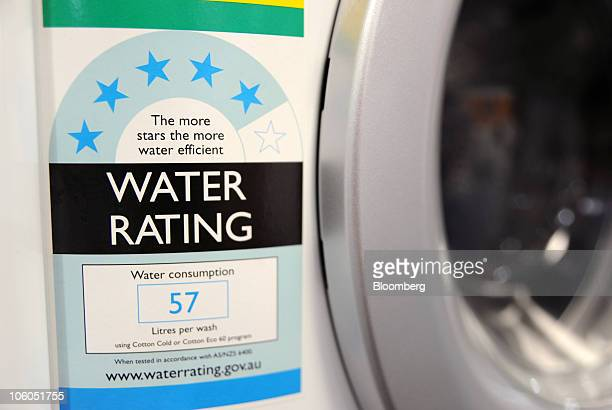A water rating sticker shows the water usage efficiency of a washing machine displayed for sale at an appliance store in Melbourne Australia on...