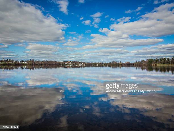 water reflecting sky and clouds - peterborough ontario stock photos and pictures