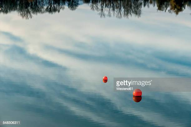 Water reflection and buoys on a lake