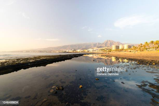 Water reflection in 'Troya I' beach in Adeje town, south of Tenerife, Canary Islands, Spain.