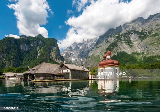Water reflection, lake Koenigssee with Watzmann Massif and pilgrimage church of St. Bartholomew, National Park Berchtesgaden, Berchtesgadener, Upper Bavaria, Bavaria, Germany