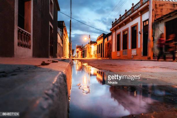 Water Reflection of a street in Gibara town at night, Cuba