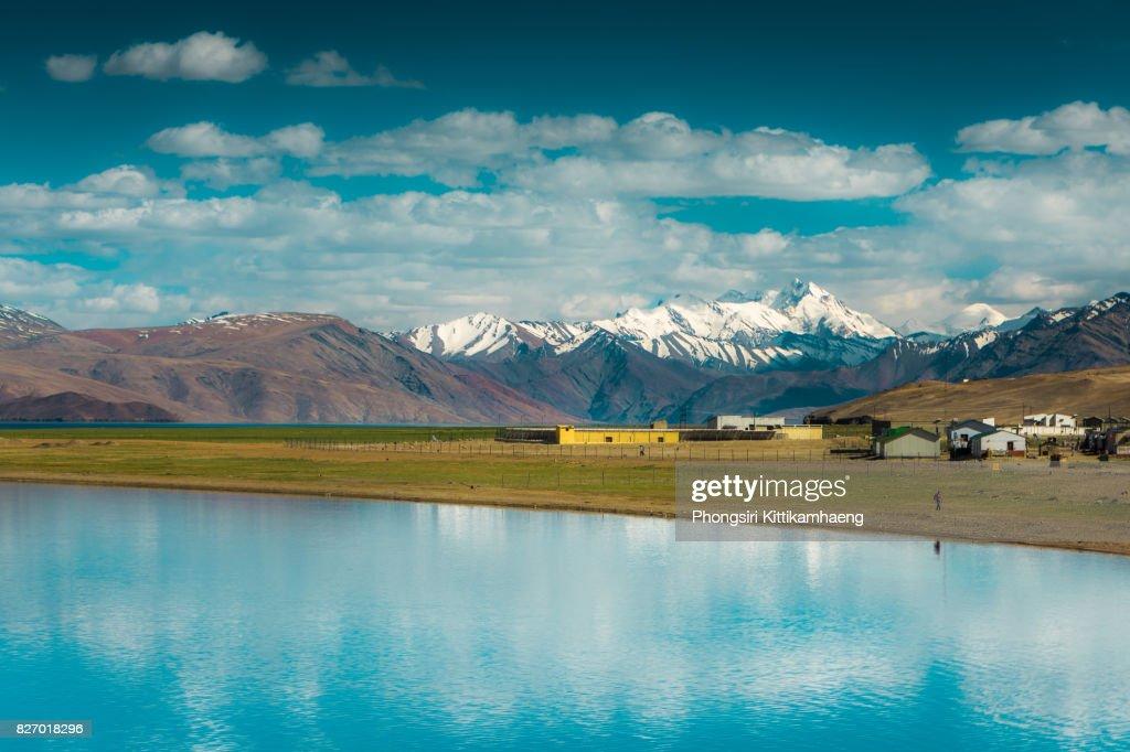 Water Reflection of town and mountain view from Tsomoriri Lake, Leh ladakh, India : Stock Photo