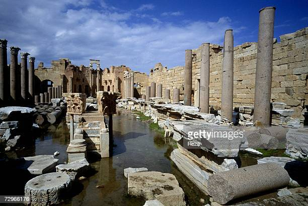 Water reflects the ruins of the Basilica in Leptis Magna the largest city of the ancient region of Tripolitania May 2000 in Leptis Magna Libya...