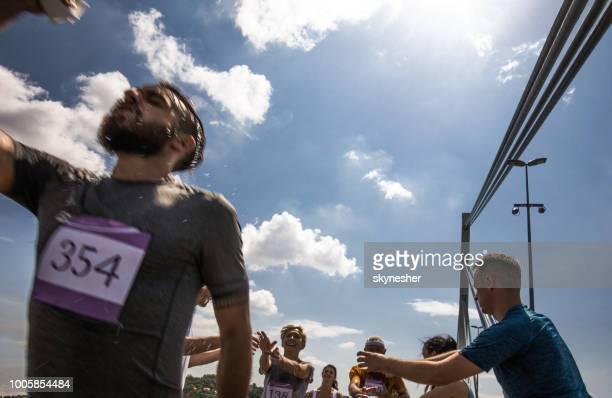 Water refreshment on marathon race during hot summer day!