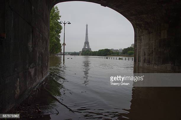 Water rises near the area of the Eiffel Tower as the Seine river's embankments overflow after three days of heavy rain on June 2 2016 in Paris France...