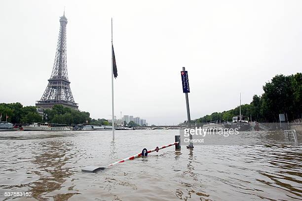 Water rises near the area of the Eiffel Tower as the Seine river's embankments overflow after four days of heavy rain on June 2 2016 in Paris France...