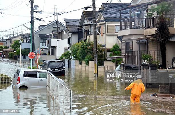 Water rose to kneehigh on flooded streets by torrential rain on August 14 2012 in Uji Kyoto Japan