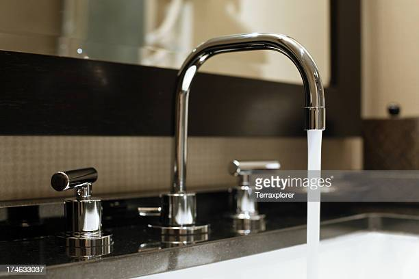 water running from faucet - sink stock pictures, royalty-free photos & images