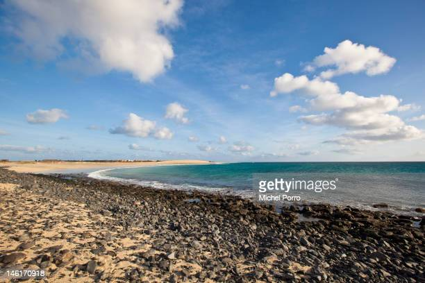 Water runs up the rocks of the beach at Santa Maria on May 15 2012 in Sal Rei Cape Verde Favorable exchange rates in the Cape Verde Islands have...