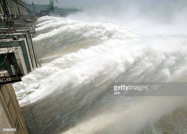 Water rushes out from the upper diversion holes for the first time through the Three Gorges Dam on the Yangtze River in Yichang central China's Hubei...