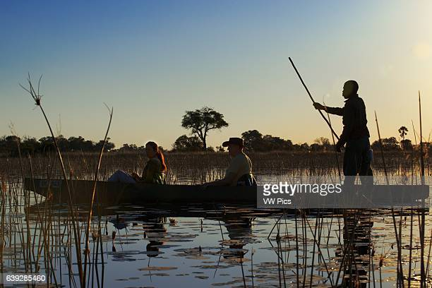 Water Safari canoe made __calls mokoro starting from Camp Eagle Island Camp by Orient Expressoutside the Moremi Game Reserve in Botswana The waters...