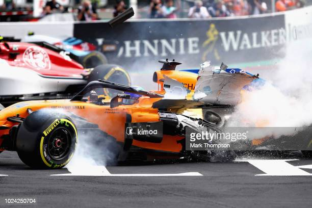 Water shoots from the car of Fernando Alonso of Spain and McLaren F1 as he crashes at the start during the Formula One Grand Prix of Belgium at...