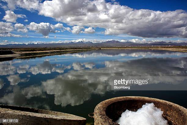 Water sits in a reservoir after being treated at the stateowned Empresa Publica Social del Agua y Saneamiento SA Puchuckollo treatment facility in...
