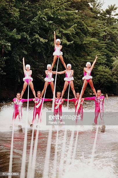 water skiers performing in formation - waterskiing stock photos and pictures