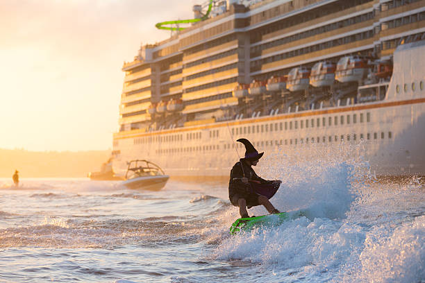AUS: Waterskiing Witches Celebrate Halloween On Sydney Harbour