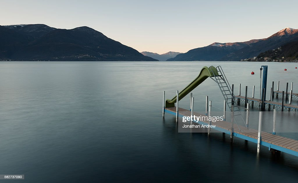 water slide at lake maggiore in switzerland stock photo getty images