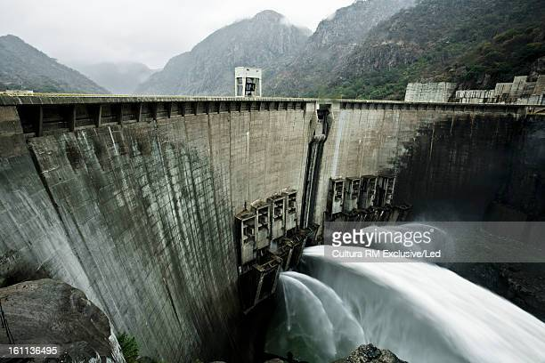 water spewing from dam - hydroelectric power station stock photos and pictures