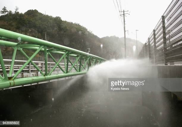 Water spews from a damaged aqueduct bridge in Oda Shimane Prefecture after a magnitude 61 earthquake hit the western Japan prefecture on the morning...