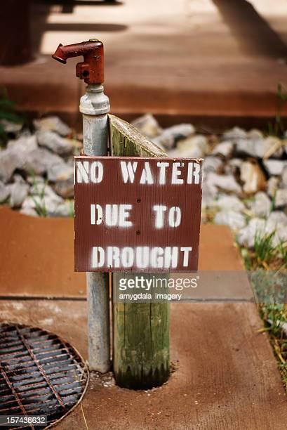 water spigot drought warning sign