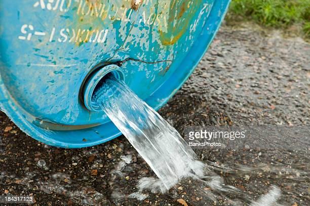 Water Spilling from a Barrel onto Asphalt
