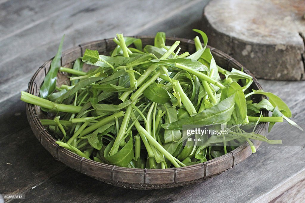 water spinach swamp cabbage kangkong in the basket : Stock Photo