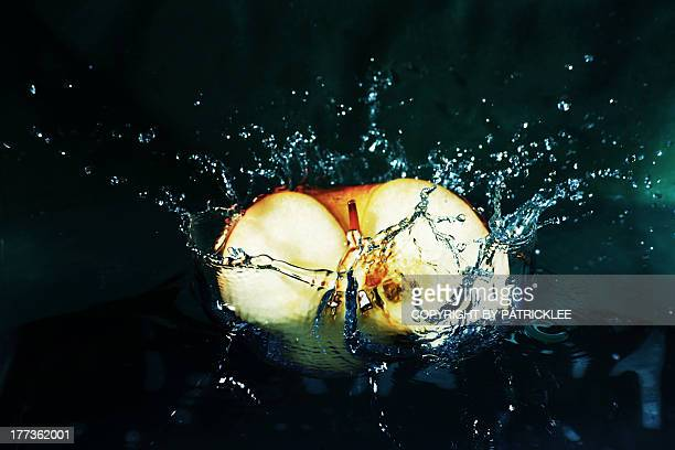 water splash with a falling apple