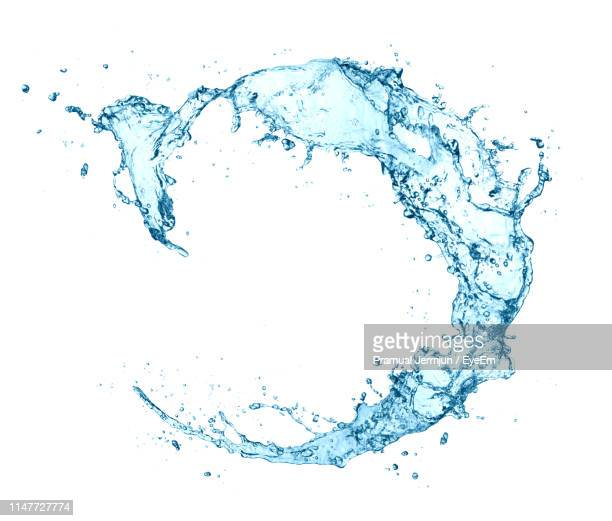 water splashing against white background - water stock pictures, royalty-free photos & images