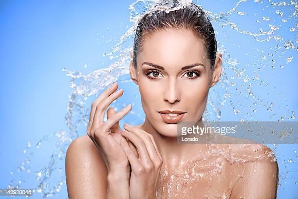 water splashing around woman