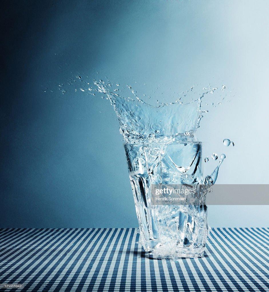 Water splashing from broken glass : Stock Photo