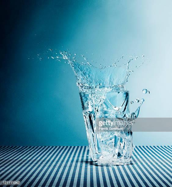 Water splashing from broken glass