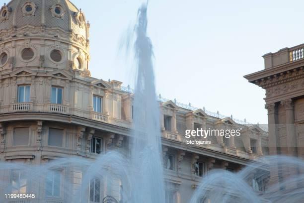 water splashing  in fountain of de ferrari square - fotofojanini foto e immagini stock