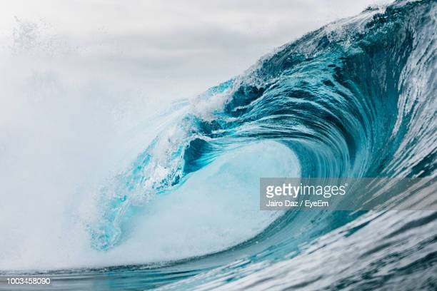 water splashing in sea against sky - wave stock pictures, royalty-free photos & images