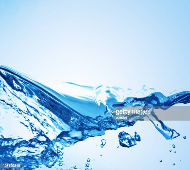 Water splashing on a blue background