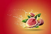 water splashing fresh figs over red