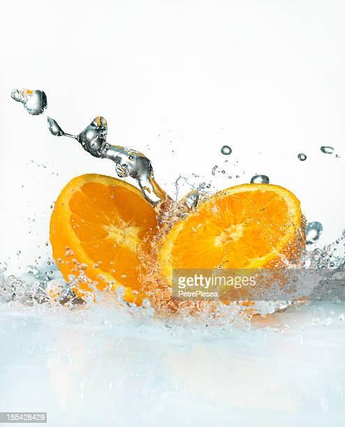 Water Splashing on Fresh Oranges