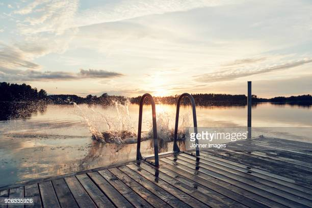 water splashing on lake - jetty stock pictures, royalty-free photos & images