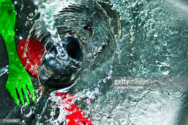 water splashing on  spoon in  kitchen sink - catherine macbride stock pictures, royalty-free photos & images