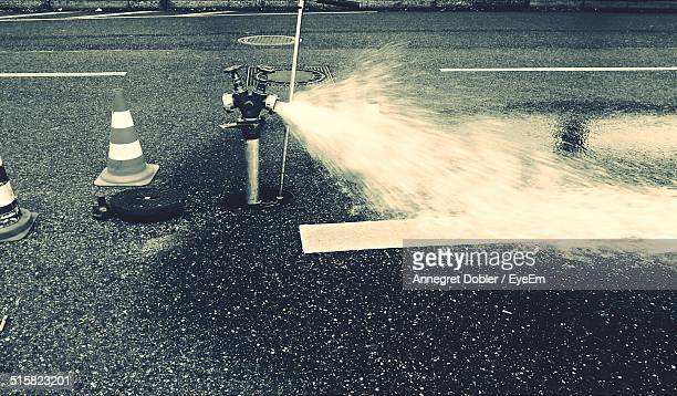 Water Splashing On Street Through Water Pump