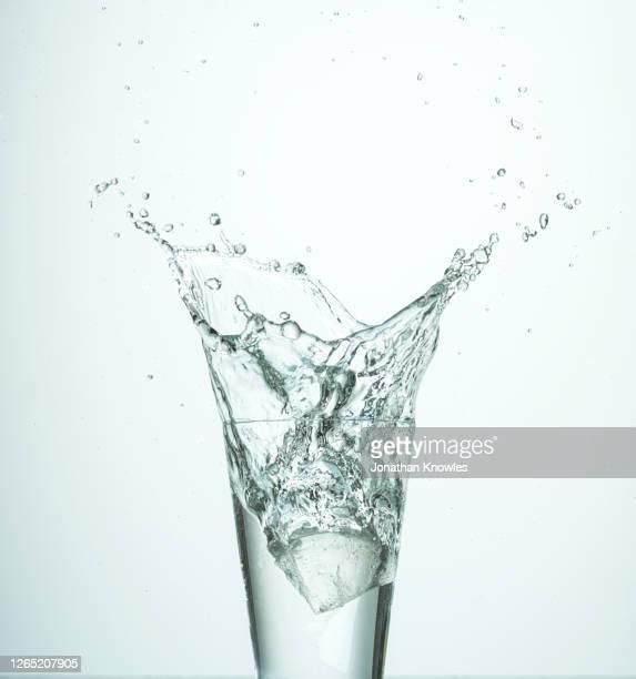 water splashing - water stock pictures, royalty-free photos & images