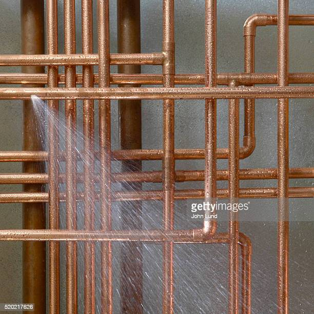 Water Spraying from Brass Pipes