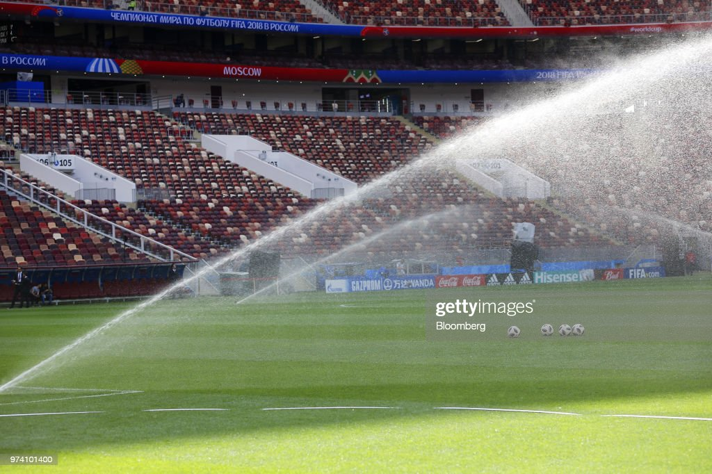 Water sprinklers spray the grass pitch ahead of the FIFA World Cup outside the Luzhniki stadium in Moscow, Russia, on Wednesday, June 13, 2018. According to an April report from the organizing committee, the total amount spent on preparations is 683 billion rubles, or about $11 billion at the current exchange rate. Photographer: Andrey Rudakov/Bloomberg via Getty Images