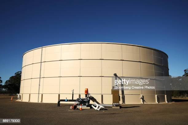 A water storage tank stands at a water treatment facility