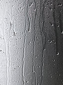 Water Streaming down glass on gray