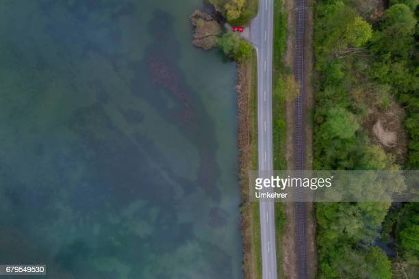 water, street and a railway - riverbank stock pictures, royalty-free photos & images