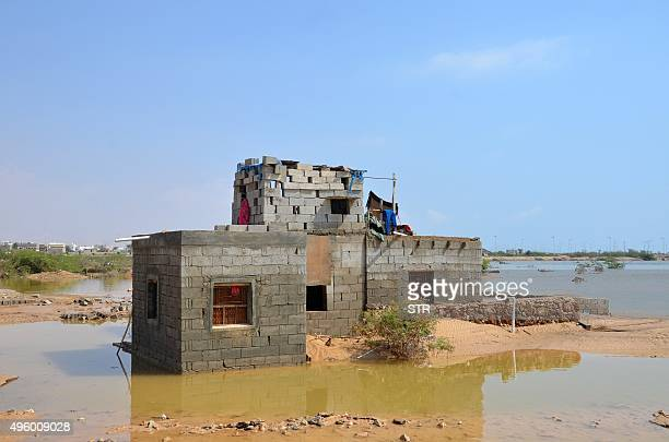 Water surrounds a Yemeni home following a tropical cyclone that has slammed into the warwracked country in Mukalla in Yemen's Hadramawt province on...