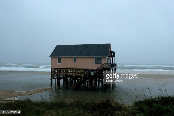 Water surrounds an ocean front beach home as Hurricane Dorian hits the area, on September 6, 2019 in Nags Head, North Carolina. Dorian passed...