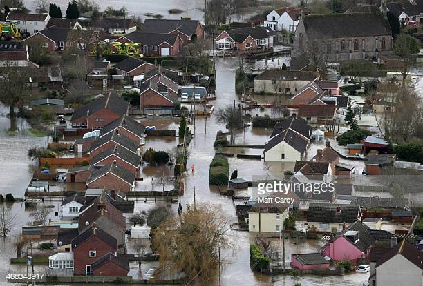 Water surrounds flooded propeties in the village of Moorland on the Somerset Levels near Bridgwater on February 10 2014 in Somerset England Thousands...