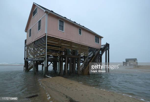 Water surrounds ocean front beach homes as Hurricane Dorian hits the area, on September 6, 2019 in Nags Head, North Carolina. Dorian passed...